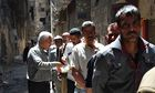 Palestinians in the besieged Yarmouk refugee camp in Damascus wait for food aid