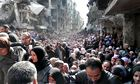Residents of the besieged Palestinian camp of Yarmouk, in Damascus, Syria