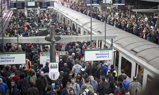 Commuters try to get on a train on the District Line of the London Underground during the 48-hour tube strike at London's Earl's Court tube station.