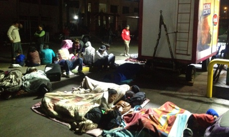 Evacuated residents sleep in the street  in Iquique