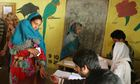 Voters cast their ballot in Kashmir