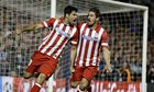 Atlético Madrid's Diego Costa celebrates with Koke after the former scored a penalt