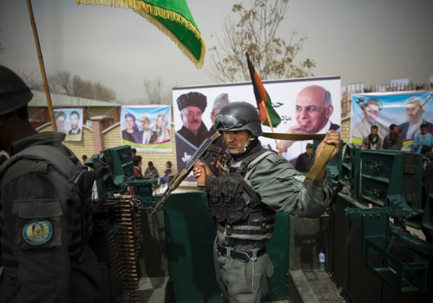 Afghan police secure the area as presidential candidate Ashraf Ghani Ahmadza arrived for a campaign rally at a stadium in Kabul