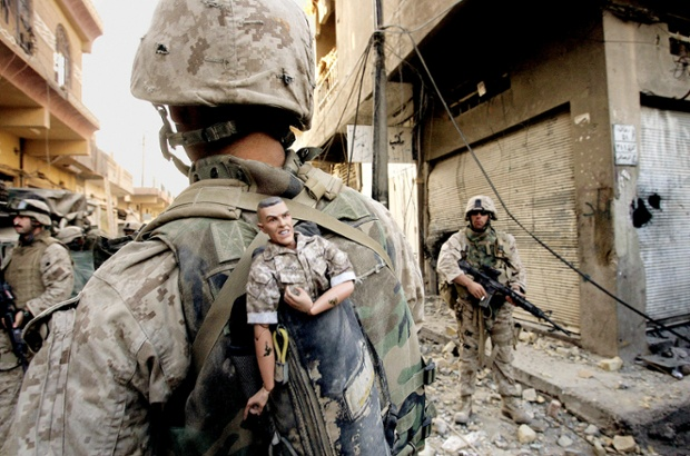 This photograph of a US marine carrying a lucky mascot as his unit pushes further into the western part of Fallujah won a Pulitzer prize in breaking news photography as part of a series of pictures of bloody combat in Iraq in 2004
