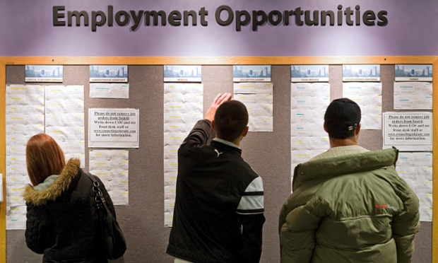 Rachel Tessean, left, and other job seekers look job listings at the Denver Workforce Center, part of the Denver Office of Economic Developme