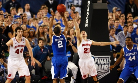 It's not deja vu, Kentucky Wildcats' Aaron Harrison really did hit another game-winning three-pointer, this time over the Wisconsin Badgers in their Final Four game. No. 8 Kentucky will go on to face No. 7 Connecticut in the NCAA Men's Division 1 Basketball Championship Game.