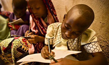 Rwandan girls completing their school work.