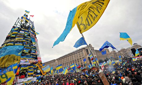 People shout slogans during a protest against Viktor Yanukovych
