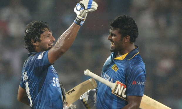 Kumar Sangakkara and Thisara Perera celebrate after winning the ICC World Twenty20 cricket tournament final.