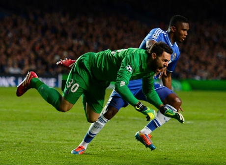 Chelsea's Samuel Eto'o struggles with Paris St-Germain's goalkeeper Salvatore Sirigu during their Champions League quarter-final second leg at Stamford Bridge.