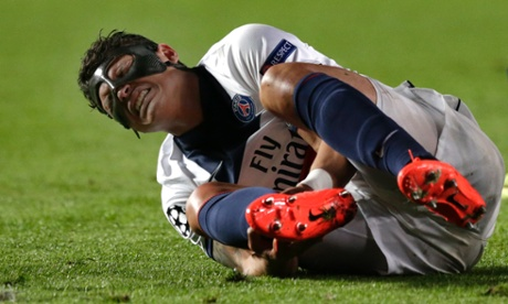 Paris St-Germain's Thiago Silva holds his ankle after a challenge by Chelsea's Samuel Eto'o during the Champions League quarter-final second leg.