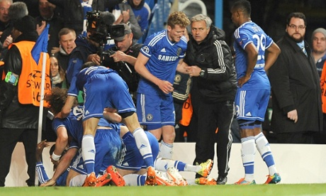 Chelsea's manager Jose Mourinho joins in the celebrations after Demba Ba scores his side's second goal during the Champions League Quarter Final against Paris St-Germain.