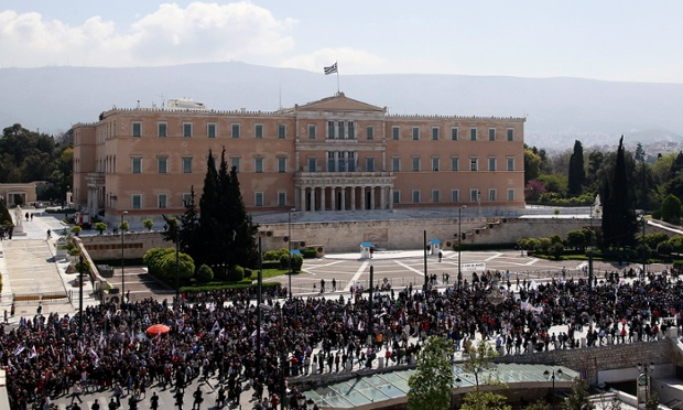 Members of pro-communist union PAME gather outside the Greek parliament building during a protest in Athens, Wednesday, April 9, 2014.