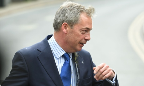 Nigel Farage is hit by an egg as he gets out of his car in Nottingham city centre.