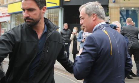 Farage with egg on back
