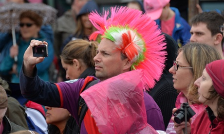 A fan takes pictures at the start of the second stage of the Giro d'Italia.