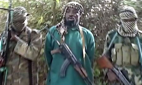 'Murderous campaign': Boko Haram leader Abubakar Shekau, flanked by two hooded fighters.