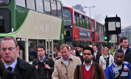Commuters walk across Waterloo Bridge in