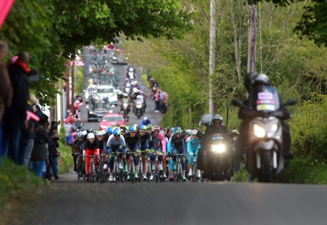 Team Orica-GreenEdge leads the peloton as they prepare to cross the border into the Irish Republic during the third stage of the Giro d'Italia.