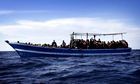 Boat carrying migrants off coast of Libya