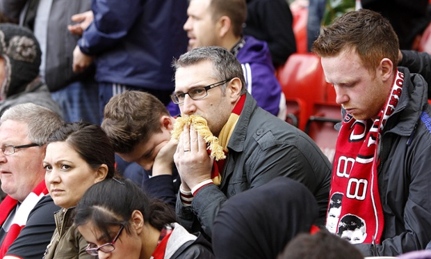Liverpool fans look dejected in the stands during the Barclays Premier League match at Anfield,
