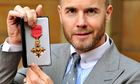 Gary Barlow with his OBE