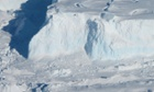 Areial viwe of an edge of the Thwaites Ice Shelf, located on Western Antarctica. the blue areas visible on the shelf edge are areas of denser, compressed ice.