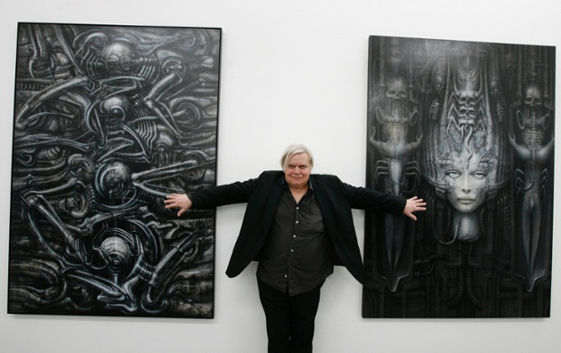HR Giger  poses with two of his works at his museum in Chur, Switzerland.