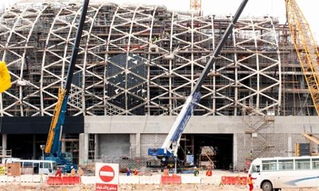 Doha, Qatar: migrant staff construct Lusail stadium