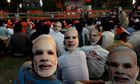 Supporters of Narendra Modi wear masks during a campaign rally in Kolkata.