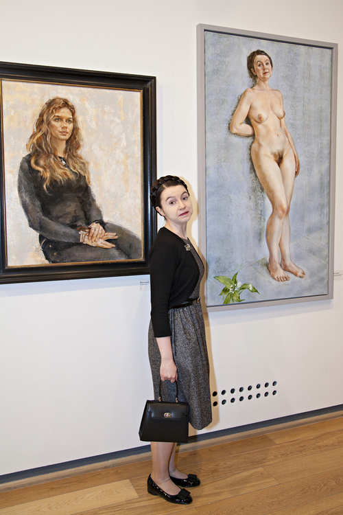 Dr Victoria Bateman poses with a nude portrait of her by Anthony Connolly