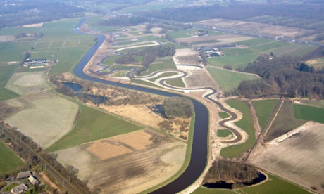 A De Dommel water board project shows how reclaimed land polders are being given back to rivers and meanders are cut into flood plains, as part of Netherland's back-to-nature approach.