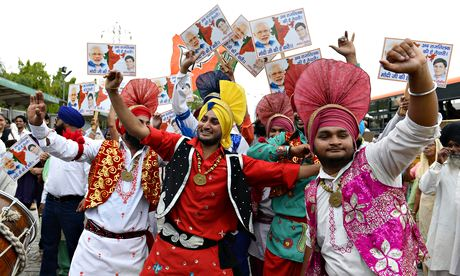 Narendra Modi supporters dance as they wait for the BJP leader to arrive in Delhi
