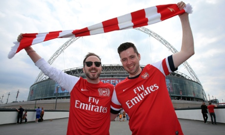 Arsenal supporters also with the obligatory scarf shot.