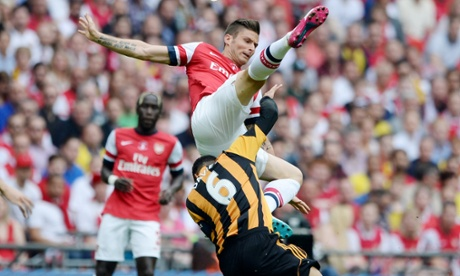 Arsenal's Olivier Giroud goes in for a challenge with goalscorer Curtis Davies.