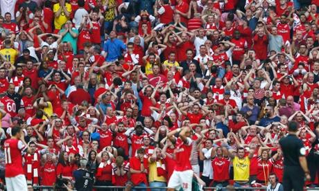 Arsenal fans react after Kieran Gibbs' miss.