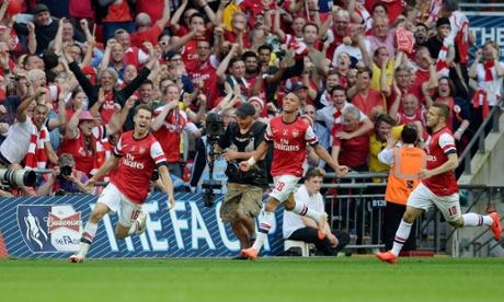 Aaron Ramsey celebrates putting Arsenal ahead.