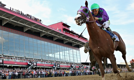 California Chrome runs to the finish line to win the 139th running of the Preakness at Pimlico