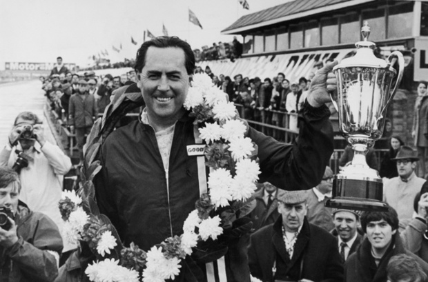 Jack Brabham holds aloft the trophy after winning the International Trophy Race at Silverstone, 1969