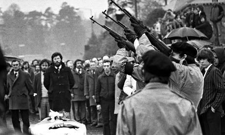 Three masked IRA men firing rifle shots over the coffin of Bobby Sands, 7 May 1981