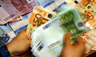 Euro banknotes being counted