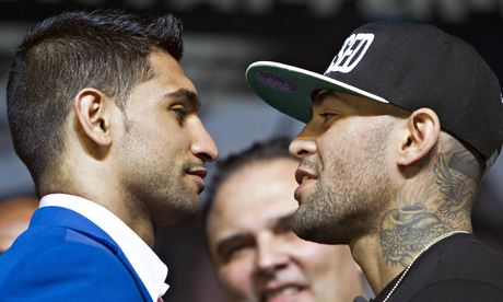 Amir Khan, left, faces his opponent, Luis Collazo, at a press conference in Las Vegas