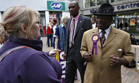 Ukip candidate Winston McKenzie, right, speaks to a woman at the carnival