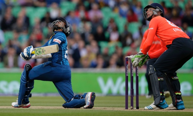 Sri Lanka's Tillakaratne Dilshan, left, hits a high shot against England.