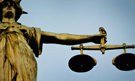 Statue Holding Scales Of Justice Is Seen Above Old Bailey As Jury Consider Verdict