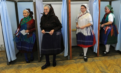 Margit Haidi, second left, and other Hungarian women wearing their traditional dresses, step out of the polling booths after voting in the European elections in Veresegyhaz, Hungary, in 2009.