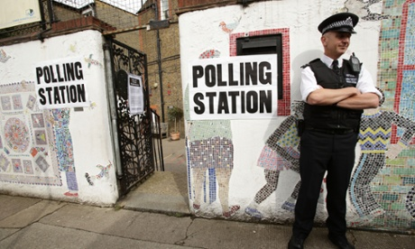 A police officer outside a polling station on Columbia Road in Tower Hamlets, east London.