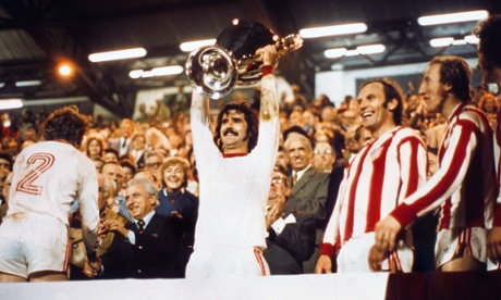 Gerd Müller celebrates with the trophy.
