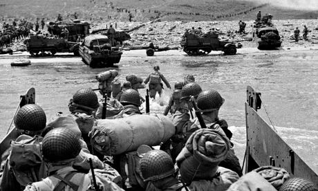 American troops in landing craft go ashore on one of four beaches in Normandy on D-Day, June 6 1944