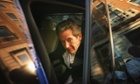 Former Chief Executive of BP, Lord Browne sits in his car after leaving the BP headquarters